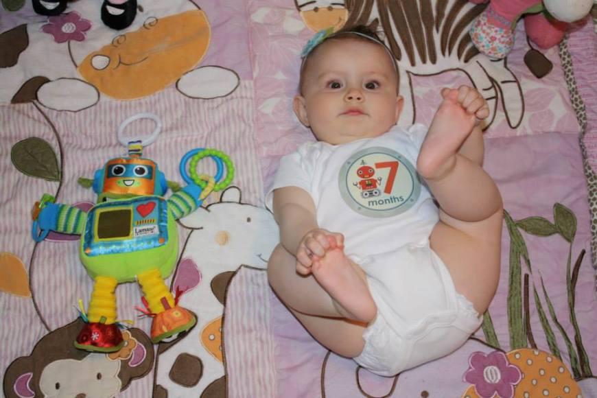Seven months old! Still loves her feet!